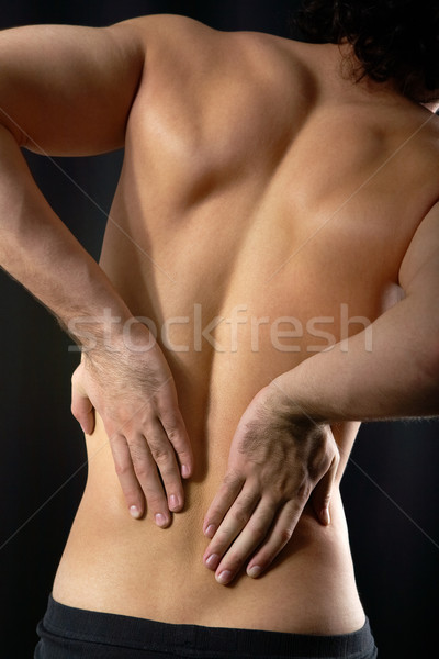Sore back Stock photo © pressmaster