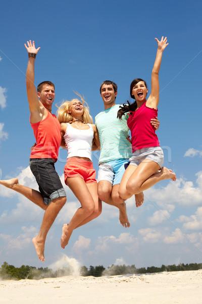 été sauter portrait quatre sautant gens heureux Photo stock © pressmaster