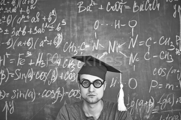 Sérieux étudiant image graduation chapeau lunettes Photo stock © pressmaster