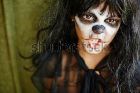 Spooky girl with lantern Stock photo © pressmaster