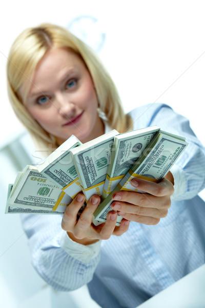 Banchiere donna fuori dollaro soldi Foto d'archivio © pressmaster