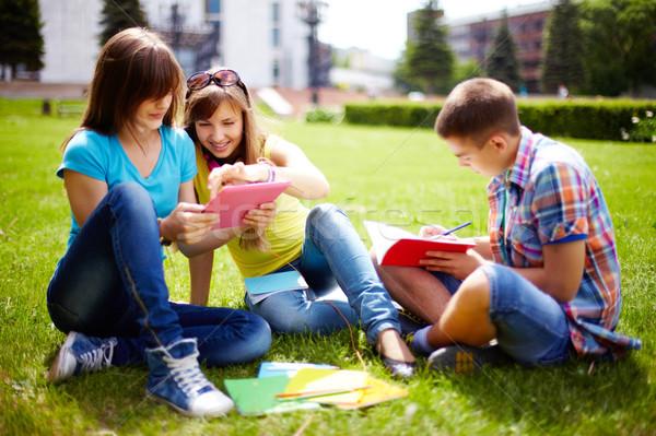 Homework outdoors Stock photo © pressmaster