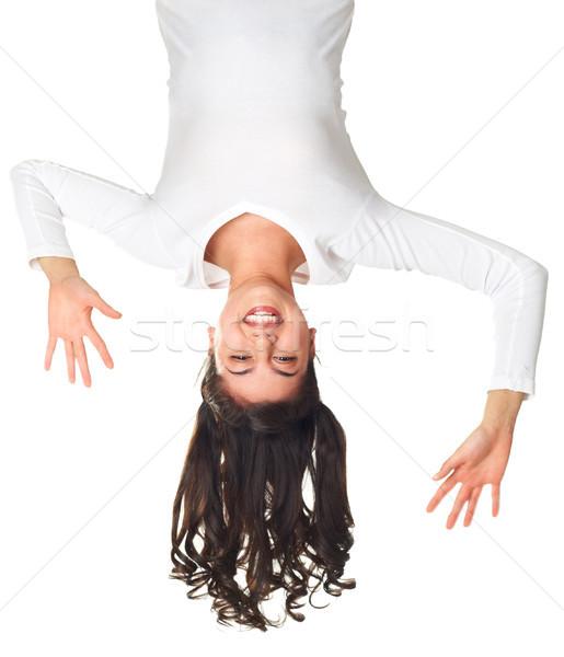 De cabeça para baixo menina enforcamento diversão retrato Foto stock © pressmaster