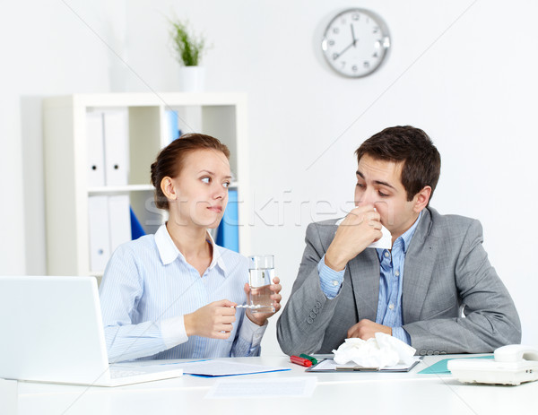 Taking care of sick co-worker Stock photo © pressmaster