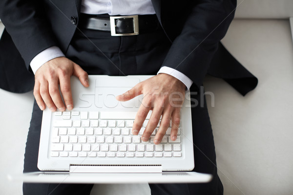 Businessman typing Stock photo © pressmaster