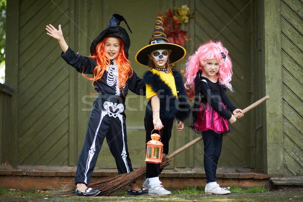 Halloween girls on broom Stock photo © pressmaster