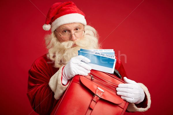 Santa with airline tickets Stock photo © pressmaster