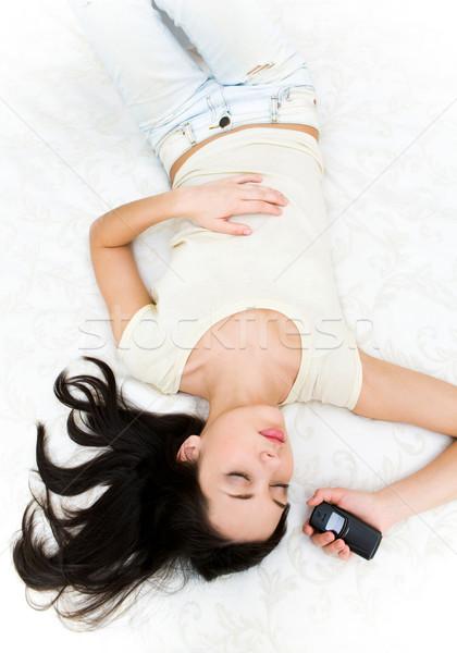 Stok fotoğraf: üzerinde · atış · uyku · genç · telefon · el