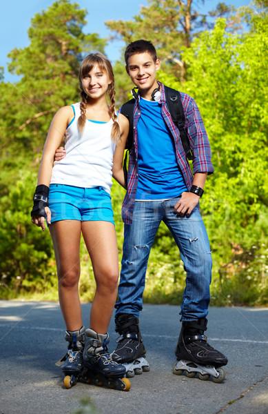 Couple of roller skaters Stock photo © pressmaster