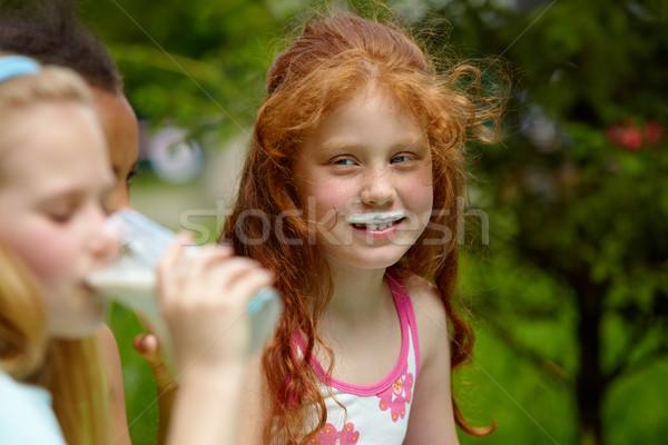 Portre sevimli kız bakıyor arkadaşlar içme Stok fotoğraf © pressmaster