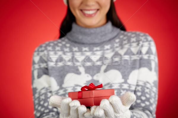Gift on hands Stock photo © pressmaster