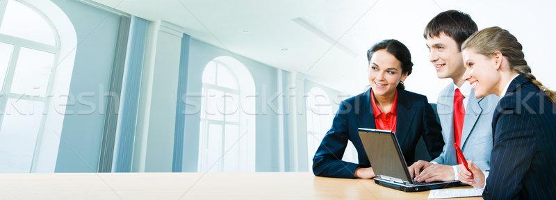 Stock fotó: Három · irodai · dolgozók · fotó · ül · asztal · irodaház