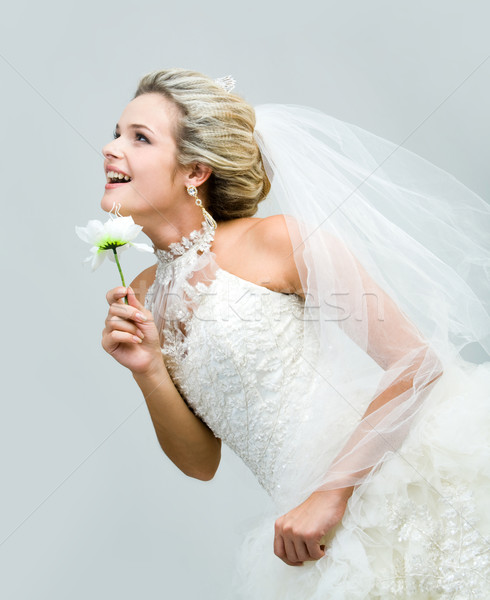 Menyasszony profil örömteli mesterséges virág néz Stock fotó © pressmaster