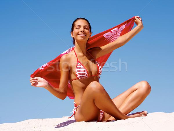 Genot foto jonge luxueus vrouw vergadering Stockfoto © pressmaster