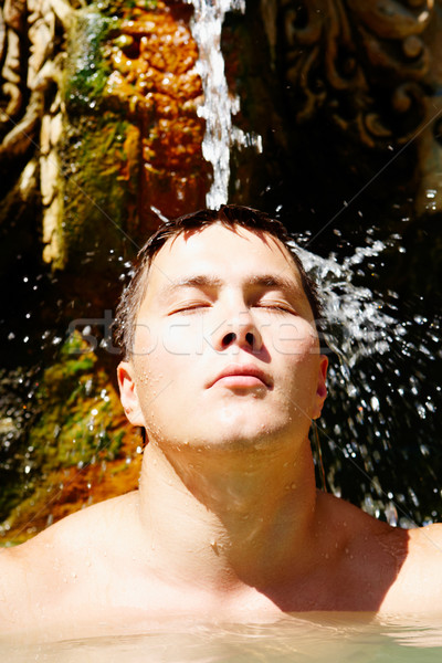 Water plezier portret jonge man stream Stockfoto © pressmaster