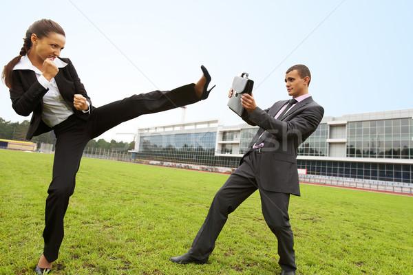 Rivaliteit portret zakenman aktetas agressief zakenvrouw Stockfoto © pressmaster