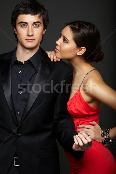 Rajongás portré jóképű férfi néz kamera gyönyörű nő Stock fotó © pressmaster
