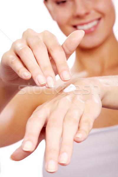 Applying handcream Stock photo © pressmaster
