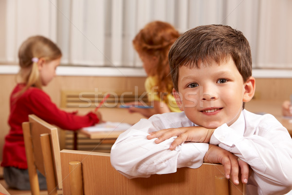 Astucieux écolier regarder caméra classe Photo stock © pressmaster