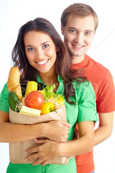 Mutlu çift sağlıklı beslenme bakıyor kamera kız Stok fotoğraf © pressmaster