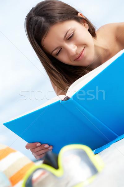 Reading on the beach Stock photo © pressmaster