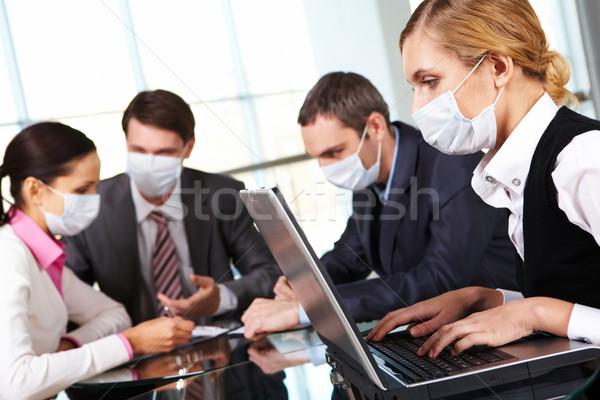 Working during flu epidemy Stock photo © pressmaster