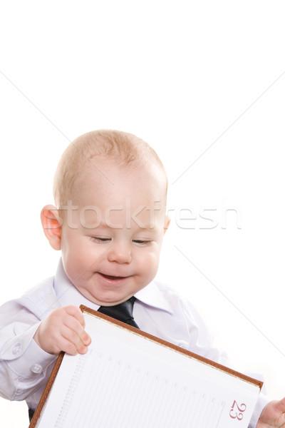 Baby with notepad Stock photo © pressmaster