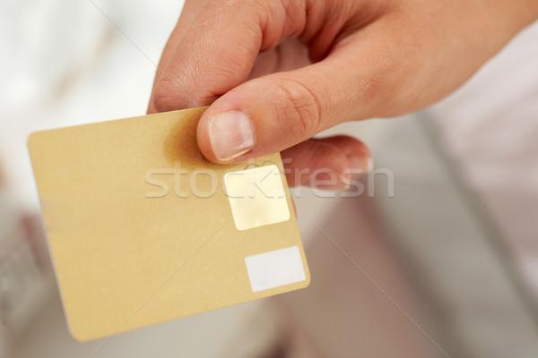Card in hand Stock photo © pressmaster