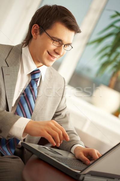 Stock fotó: Irodai · munka · portré · elfoglalt · menedzser · gépel · laptop