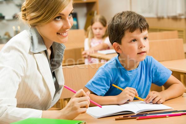 érdekes portré fiatal tanár ül egy Stock fotó © pressmaster