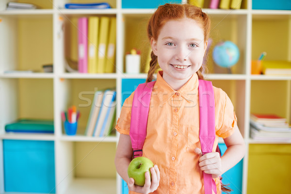 Schoolgirl with apple Stock photo © pressmaster