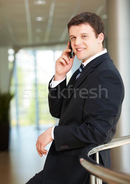 Hív fotó jóképű munkáltató beszél telefon Stock fotó © pressmaster
