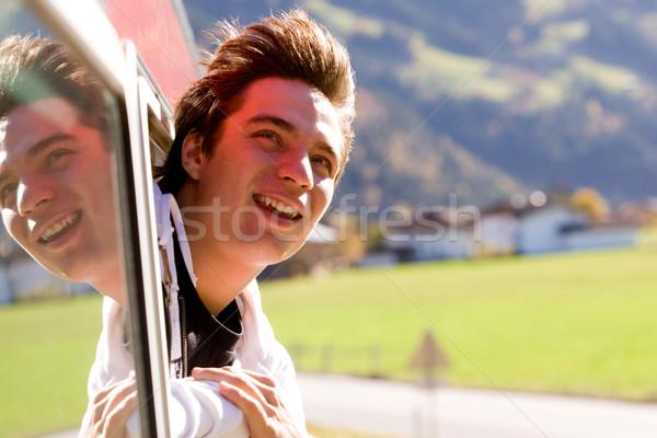 örömteli utazó fotó derűs néz ki Stock fotó © pressmaster