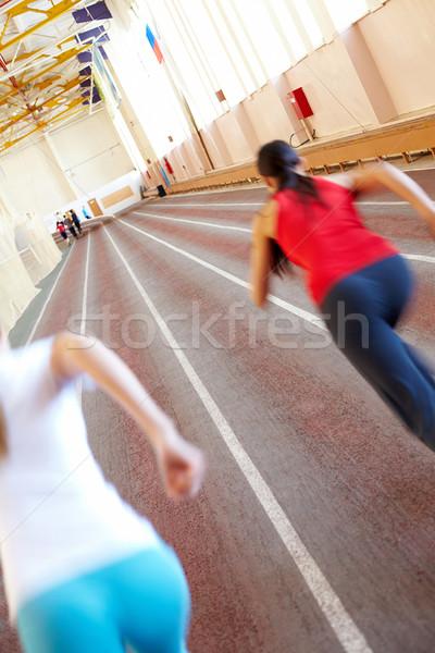 Konkurencja sala gimnastyczna zamazany uruchomiony sylwetki kobieta Zdjęcia stock © pressmaster