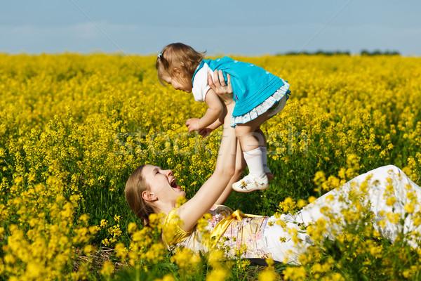 Kislány anya baba citromsárga mező nő Stock fotó © prg0383