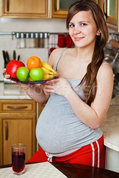 красивой беременная женщина кухне здоровое питание женщину девушки Сток-фото © prg0383
