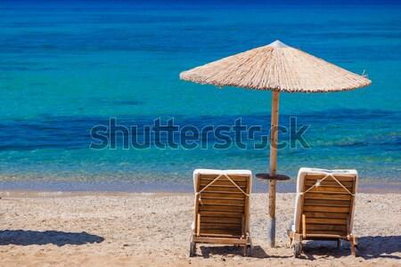 Ver cadeiras de praia guarda-chuvas Grécia praia céu Foto stock © prg0383