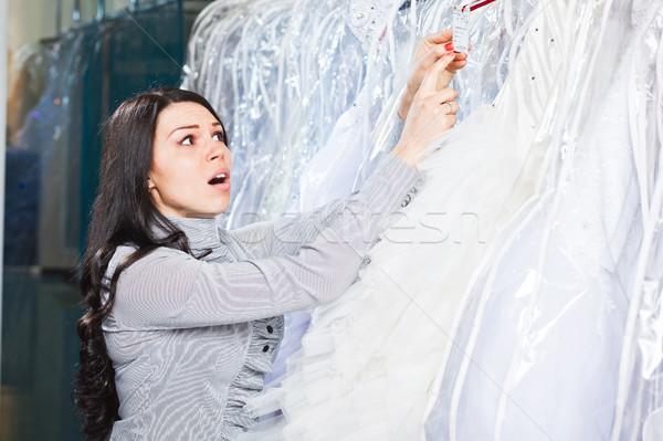 Beautiful girl chooses her wedding dress.  Portrait in Bridal sa Stock photo © prg0383