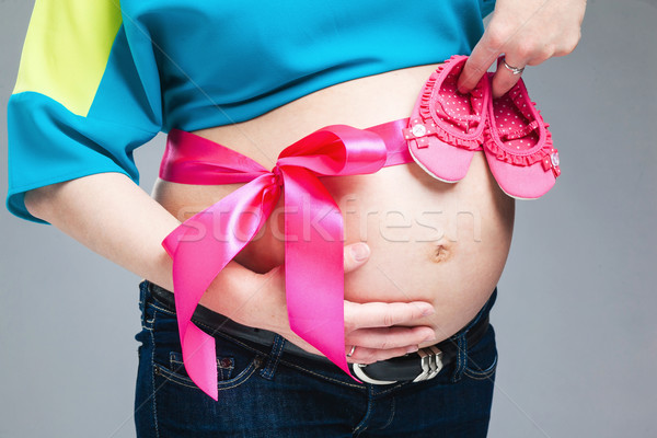 Pregnant belly with pink ribbon. Stock photo © prg0383