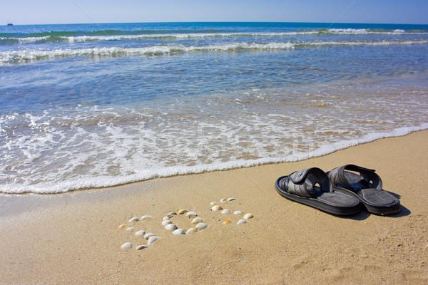 Strand opschrift sos zand slippers boot Stockfoto © prg0383