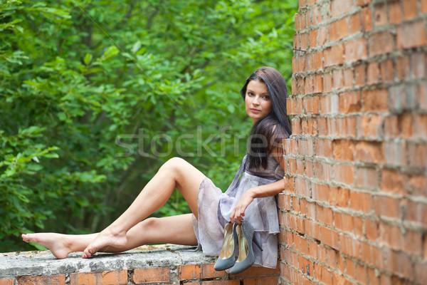 Fiatal nő lány ül öreg fal kezek Stock fotó © prg0383