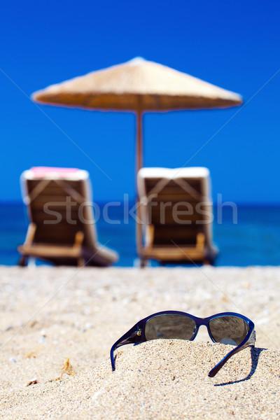 синий цвета морем Солнцезащитные очки песок Focus Сток-фото © prg0383