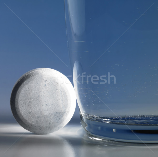 fizzy tablet beside a glass of water Stock photo © prill