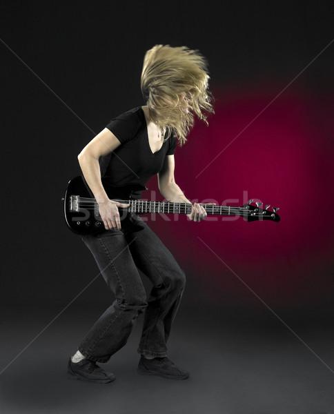 Játszik basszus gitár nő fekete részben Stock fotó © prill
