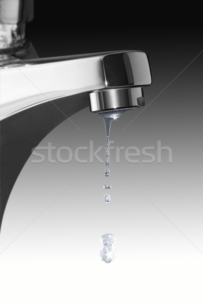 dripping faucet and water drops Stock photo © prill
