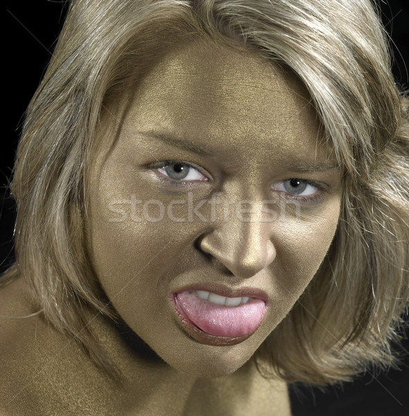 angry woman with golden face Stock photo © prill