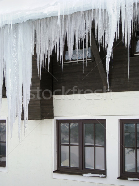 icicles in front of a house facade Stock photo © prill