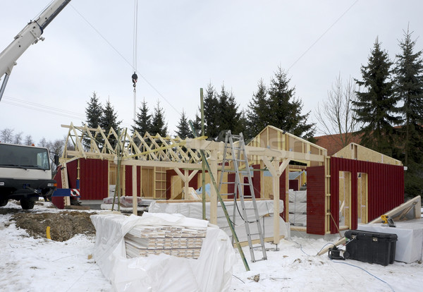 wooden house construction at winter time Stock photo © prill