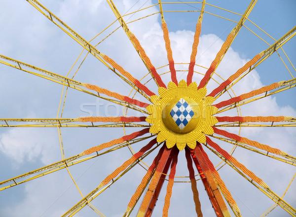 Veelkleurig groot wiel detail blauwe hemel wolk Stockfoto © prill