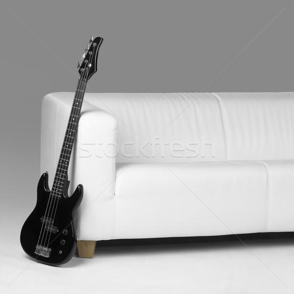 Siyah bas gitar beyaz kanepe gri Stok fotoğraf © prill